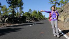 Travel woman hitchhiking Stock Footage