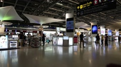 People in duty free store inside Bangkok international airport in Thailand Stock Footage