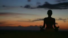 Meditation - Yoga woman meditating at beach sunset Stock Footage