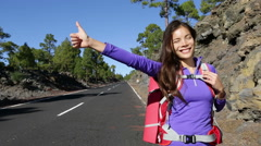 Hitchhiker woman backpacker hitchhiking Stock Footage