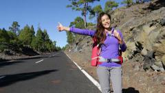 Hitchhiking woman backpacker hitchhiker - stock footage