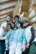 Group portrait in winter clothes, three quarter length, low angle view - stock photo