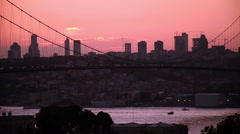 Bosporus, Bosphorus, Bridge, pink silhouette, skyscraper cars cross, at Istanbul Stock Footage