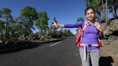 Travel hitchhiker woman backpacking hitchhiking - stock footage