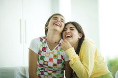 Young female friends laughing Stock Photos
