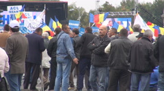 Romania national flags in people hands, democratic elections in country, support Stock Footage