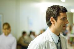 Doctor, hospital waiting room in background Kuvituskuvat