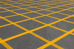 Squares with yellow lines on tarmac, seen in fuerteventura, spain Stock Photos