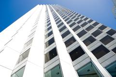 Building exterior, high rise, low angle view - stock photo