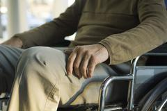 Handicapped person in wheelchair - stock photo