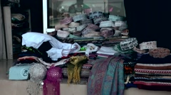 Muttrah (Matrah) Oman sultanate 028 souvenir shop window with clothes Stock Footage