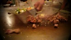 Japanese chef cooking vegetables and beef in Asian restaurant Stock Footage