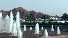 Muttrah (Matrah) Oman sultanate 030 fountains in front of mountain landscape Stock Footage