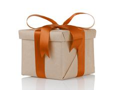 one gift christmas box wrapped with kraft paper and orange bow - stock photo