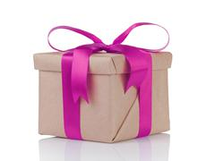 One gift christmas box wrapped with kraft paper and purple bow Stock Photos