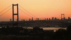 Silhouette of Bosporus Bridge Istanbul at sunset Stock Footage