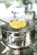 Penne pasta cooked al dente - stock photo