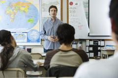 Teacher addressing high school class - stock photo