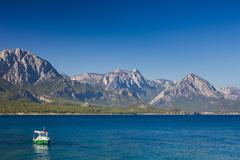 Beautiful view of kemer town and boat in the mediterranean sea Stock Photos