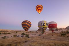 Goreme - october 11: colorful hot air balloons flying over rock landscape at  Stock Photos