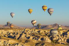 Goreme - october 09: colorful hot air balloons flying over rock landscape at  Stock Photos