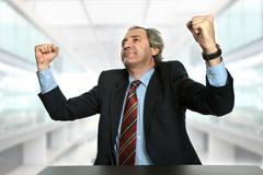 Business man with open arms, winning, at the office Stock Photos