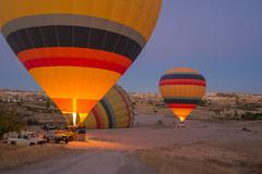 Goreme - october 10: colorful hot air balloons inflating before the flight at Stock Photos
