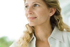 Woman smiling, head and shoulders, close-up Stock Photos