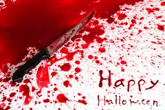 Halloween concept : bloody knife with blood splatter Stock Photos