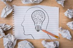 white note book paper with  pencil draw  light bulb inside a head and crumple - stock illustration
