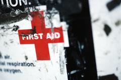 First aid sign, close-up - stock photo