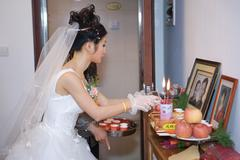 Chinese wedding, bride taking offering to ancestral shrine Stock Photos