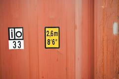 Dimensions marked on side of cargo container, close-up Stock Photos