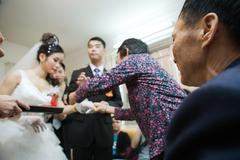 Chinese wedding tea ceremony, focus on senior man in foreground Stock Photos