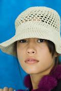 Teenage girl wearing hat, looking at camera, portrait - stock photo