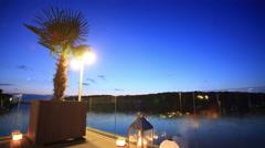 Sunset over beautiful wedding decoration near lake timelapse Stock Footage