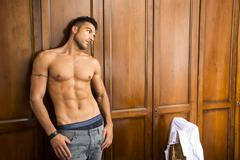 sexy handsome young man standing shirtless - stock photo