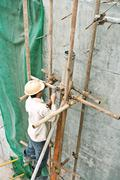 Construction worker working at construction site Stock Photos