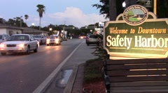 Safety Harbor Main Street and Welcome to Downtown Sign at Dusk Stock Footage