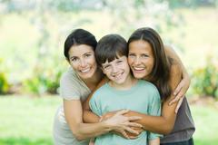 Mother with son and teenage daughter, smiling at camera, portrait Stock Photos