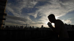 Boxer Sparring Sunset Boxing Silhouette Punches NYC Manhattan Skyline 4K - stock footage