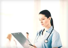 Stock Photo of female doctor or nurse in hospital