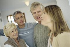 Couple visiting with in-laws Stock Photos