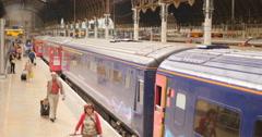 Passengers pulling luggage at Paddington station 4K Stock Footage