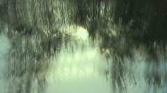 Reflection of trees and sunset in water-slow motion effect Stock Footage