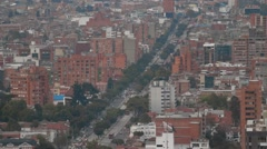 Rooftop evening Shot of Caracas Avenue and the cityscape of Bogota Stock Footage