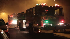 Two fire engines in smoke 2 Stock Footage