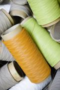 Stock Photo of Recyclable composite textile fabrication department of factory, reels of excess