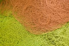 Stock Photo of Recyclable composite textile fabrication department of factory, coated thread in