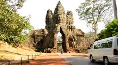 Cars Drive through Temple on Bridge - Angkor Wat Stock Footage